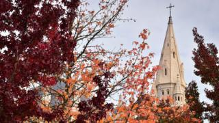 A picture taken on October 18, 2018 shows the Sainte-Bernadette church as autumn dead leaves fall down