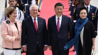 """US Secretary of State Rex Tillerson (2nd L) and his wife Renda St. Clair (L) greet the President of the People""""s Republic of China Xi Jinping (2nd R)and his wife Peng Liyuan (R) as they arrive to Palm Beach International Airport on Thursday, April 6, 2017 in West Palm Beach, Fla."""