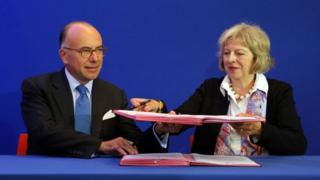 Theresa May and French Interior Minister Bernard Cazeneuve