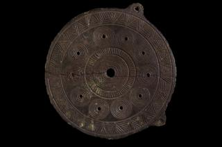 Bronze Age copper alloy 'sun disc'