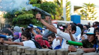 Demonstrators fire a homemade mortar during a protest against Nicaraguan President Daniel Ortega's government in Managua, May 30, 2018