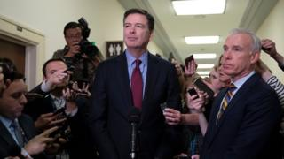 Former FBI Director James Comey (C) talks to reporters following a closed House Judiciary Committee meeting in December 2018