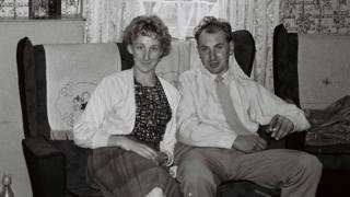A couple sitting on the sofa