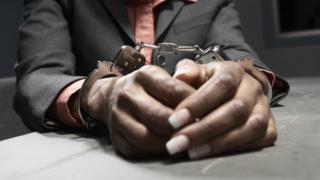 Black person in handcuffs