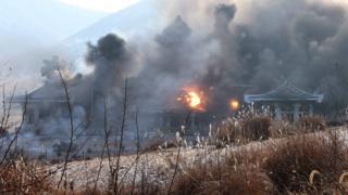 貌似韩国青瓦台的楼房被猛烈轰炸(朝中社2016年12月11日发放图片)