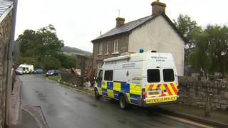 police vehicles outside a house