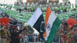 akistani Rangers (black) and Indian Border Security Force personnel (brown) perform perform during the daily beating of the retreat ceremony at the India-Pakistan Wagah Border Post, some 35kms west of Amritsar on August 14, 2017