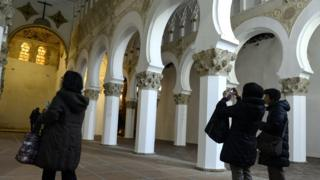 Tourists take pictures in the 12th Century synagogue of the Santa Maria La Blanca in Toledo