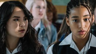 Amandla Stenberg (right) with another cast member in The Hate U Give