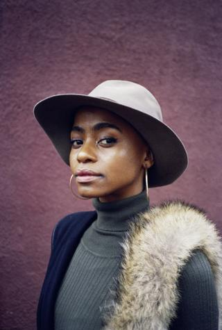 A woman in a hat.
