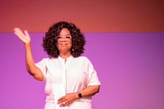 US TV personality Oprah Winfrey waves during an event to mark 100 years since the birth of Nelson Mandela, at the University of Johannesburg, Soweto Campus, in Johannesburg, South Africa - 29 November 2018