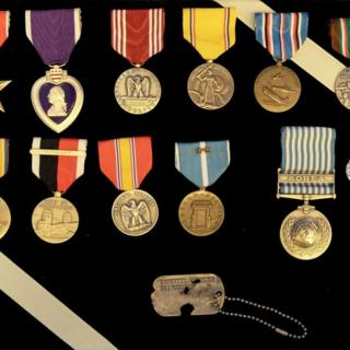Colourful medals and the dog tag of Army Master Sgt Charles Hobert McDaniel