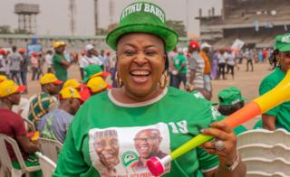 Woman wearing a hat that says Atiku Babes