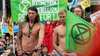 Extinction Rebellion activists block an intersection in Melbourne