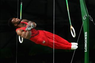 Courtney Tulloch of England competes in the men's team final and individual qualification in artistic gymnastics