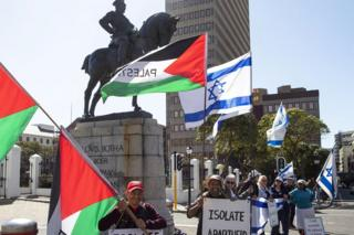 Rival protesters - some pro-Palestinian, others pro-Israel - stand outside parliament in Cape Town, South Africa - Friday 24 August 2018