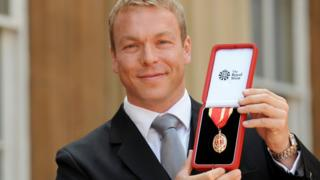 Olympic gold medalist Chris Hoy with the Knighthood he received from the Prince of Wales during the investiture ceremony at Buckingham Palace.