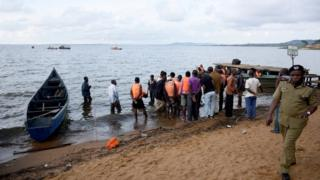 People at the scene of the Uganda sinking
