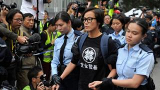 Singer Denise Ho is being arrested and escorted by police officers during the clearance of Occupy Central Pro-democracy camp in Admiralty