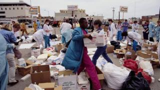 Relief workers carry boxes of medical supplies during the aftermath of the Oklahoma City bombing