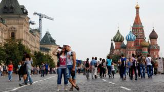 A couple stood in front of St Basil's Cathedral in Moscow's Red Square in Russia.