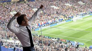 Emmanuel Macron celebrating France's win from the stands