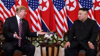 "US President Donald Trump (L) speaks with North Korea""s leader Kim Jong Un during a meeting at the Sofitel Legend Metropole hotel in Hanoi on February 27, 2019."