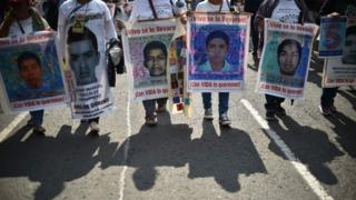 In this file photo taken on 26 September 2019 people protest in Mexico City to mark five years of the disappearance of the 43 students of the teaching training school in Ayotzinapa