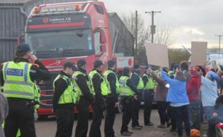 Trucks leave site