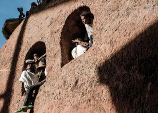 Ethiopian Orthodox pilgrims attend the Christmas celebrations at Saint Mary's Church in Lalibela, Ethiopia - Monday 7 January 2019