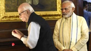 Prime Minister Narendra Modi (R) and Senior BJP leader L K Advani pay tribute at Parliament House on July 6, 2018 in New Delhi.