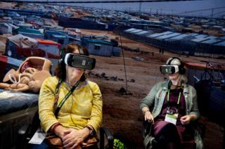 Conference participants watch the virtual reality movie at the 4th Women Deliver Conference in Copenhagen, Denmark
