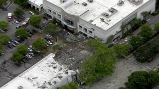 Aerial shot of LA fitness with debris outside