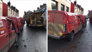 Damaged Royal Mail vans after a digger fell on them