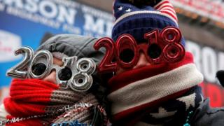 "Revelers gather in Times Square as a cold weather front hits the region ahead of New Year""s celebrations in Manhattan, New York, U.S., December 31, 2017."