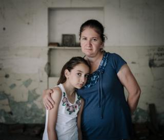 Aneta and Alana pictured in the room where they were held captive, 10 years on