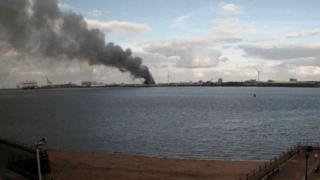 The fire has sent huge plumes of smoke into the sky