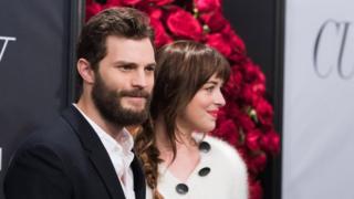Jamie Dornan, left, and Dakota Johnson attend a special fan screening of Fifty Shades of Grey
