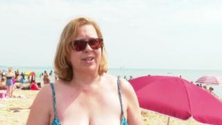 Woman in blue bikini on beach