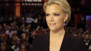 In this Jan. 28, 2016 file photo, Moderator Megyn Kelly waits for the start of the Republican presidential primary debate in Des Moines, Iowa.
