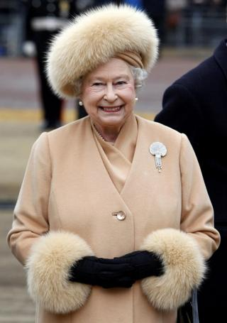 24/02/09 of Queen Elizabeth II in a fur coat, as she no longer uses fur in her outfits, having switched to fake fur this year,