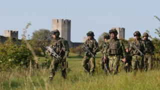 This picture taken on 14 September 2016 shows Swedish military patrolling outside Visby, on Gotland island, Sweden