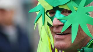 Man in a marijuana mask
