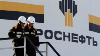 Workers and Rosneft logo
