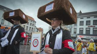 People wearing fake noses and fur hats intended to depict Orthodox Jews during Aalst carnival, 23rd February 2020