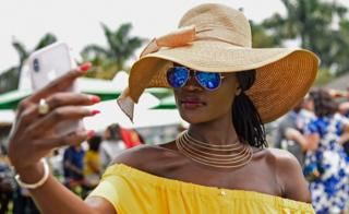 A woman taking a selfie at the Royal Ascot Goat Races in Kampala, Uganda - Saturday 25 August 2018