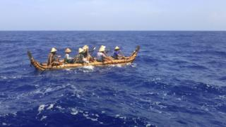 One of the two hand-built canoes being paddled toward Okinawa Prefecture in Japan