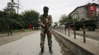 Indian Army soldiers stand guard near Badam Bagh during restrictions in civil lines area of Srinagar, the summer capital of Indian Kashmir, 27 August 2016.