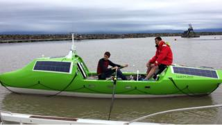 the two men are pictured on their rowing vesell