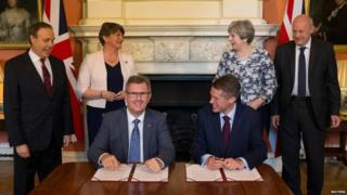 DUP MP Jeffrey Donaldson and Tory Chief Whip Gavin Williamson sign agreement, June 2017